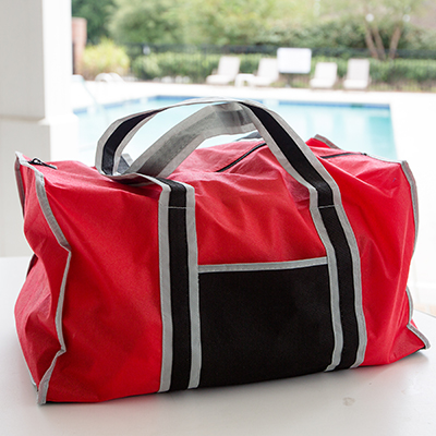 "TOPPERS™ Enviro Friendly Duffel Bag - This eco-friendly reusable duffel bag features a large main compartment with reinforced bottom and zippered closure, an outer pocket and 24"" shoulder straps. Bag measures 18"" x 10.5"" x 10.5""."